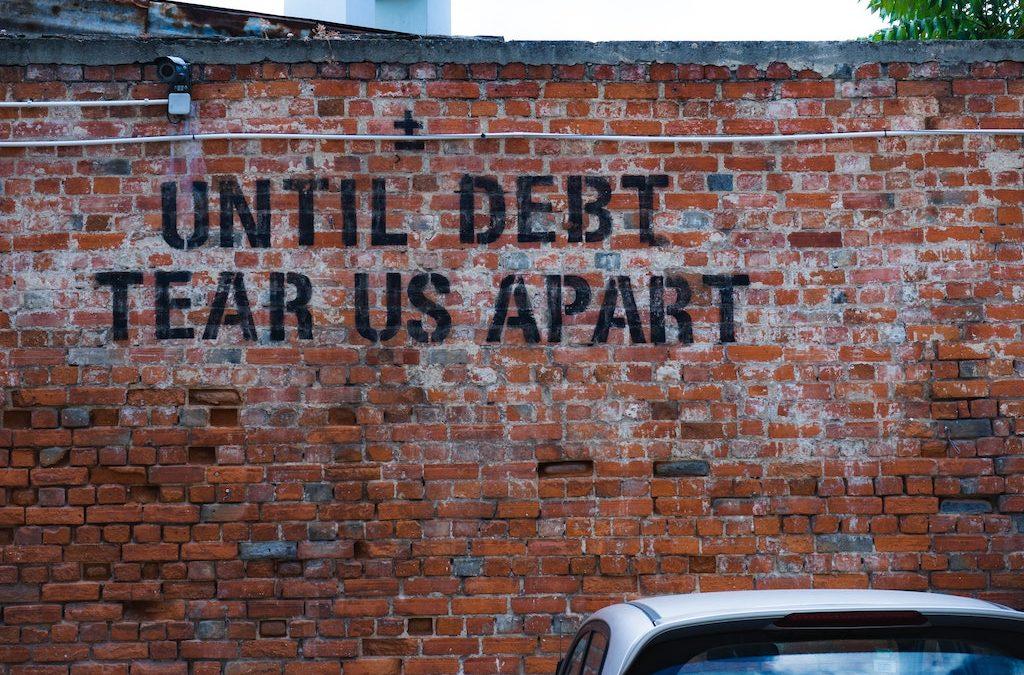 Drowning in Debt? 7 Ways to Break Free